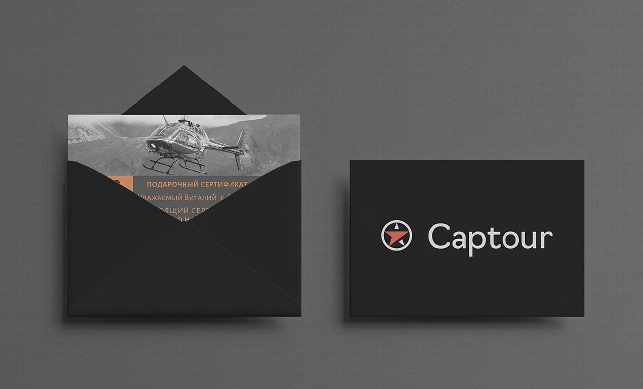 """Подарочный сертификат на полет на вертолете в фирменном конверте от компании """"Captour"""""""